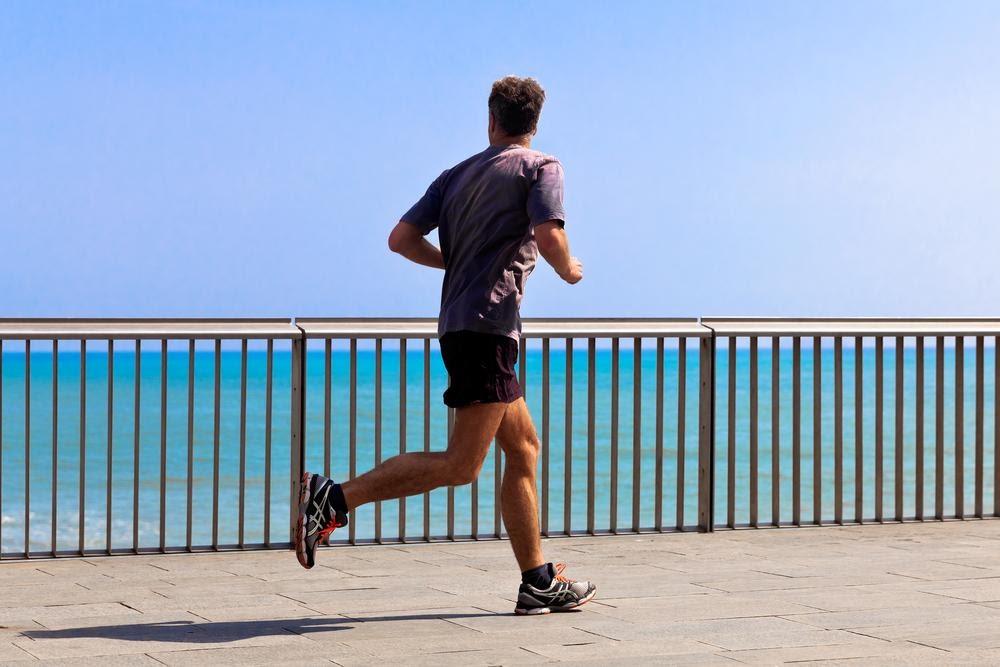 runner running looking at the sea