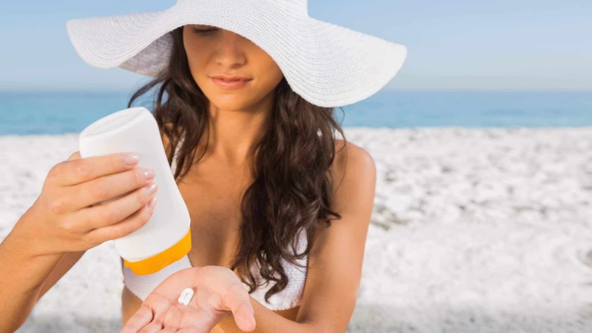 woman applying suncream to hand scaled