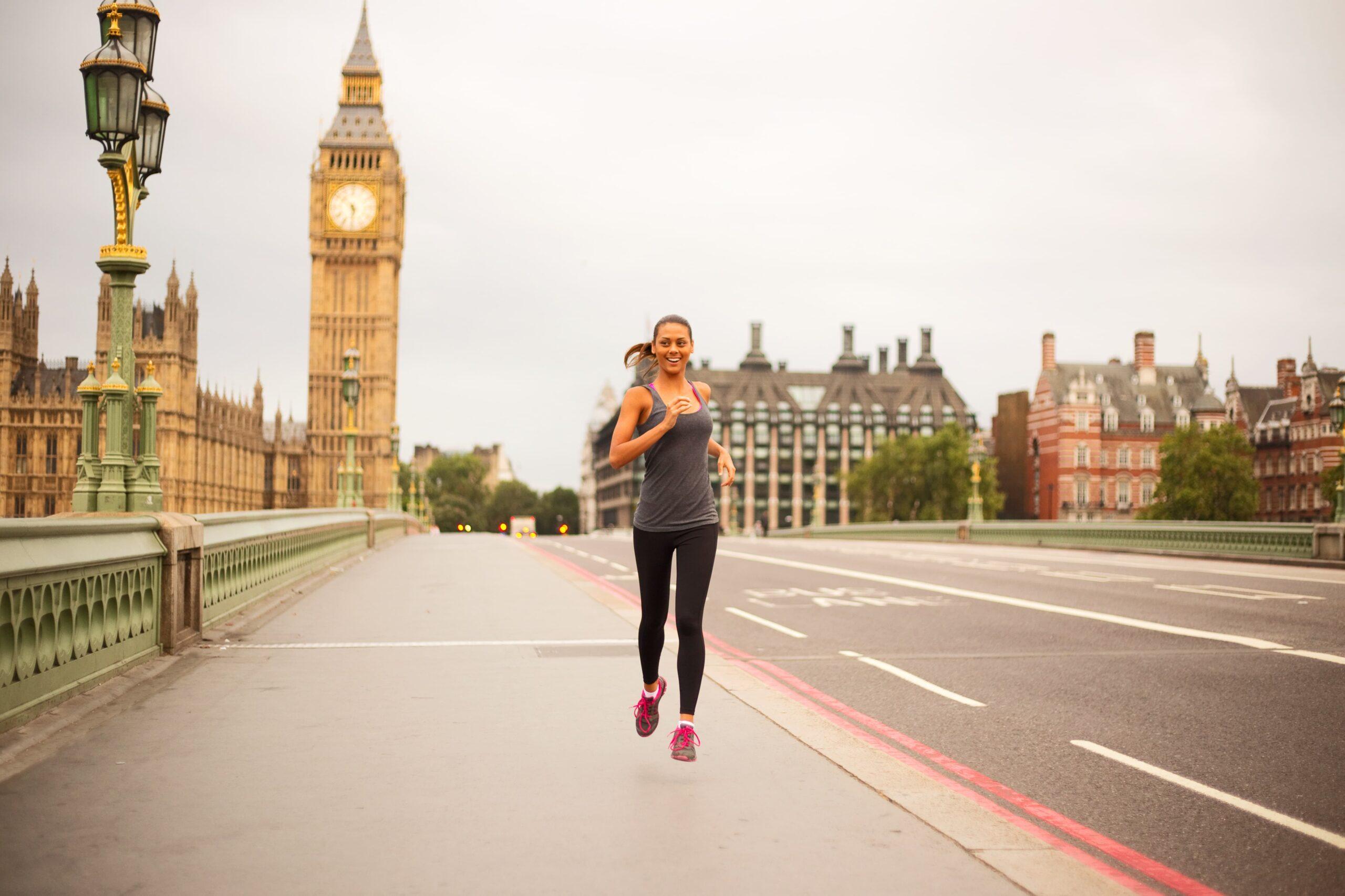 woman running across westminster bridge