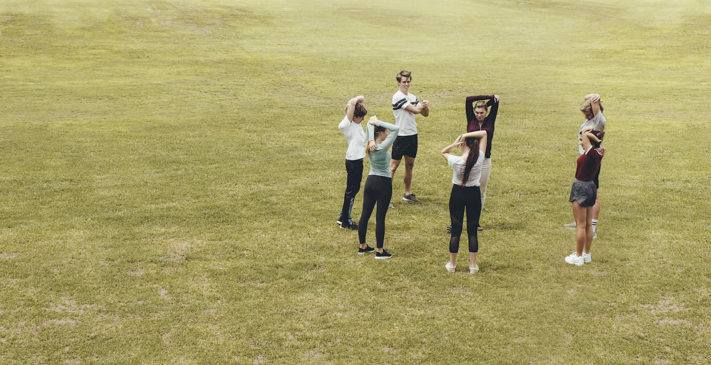 students exercise in field
